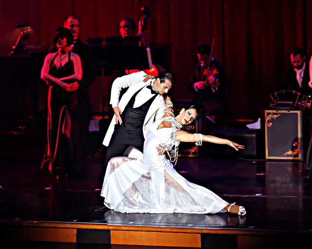 Couple in tango finale in white